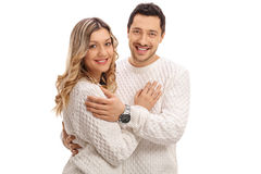 Happy young couple in an embrace smiling. And looking at the camera isolated on white background Royalty Free Stock Images