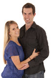 Happy young couple embraced looking at camera Royalty Free Stock Photos