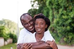 Happy young couple embracing in countryside. Royalty Free Stock Photos