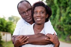 Happy young couple embracing in countryside. Stock Images