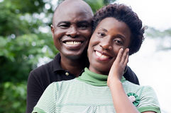 Happy young couple embracing on a green background. Royalty Free Stock Photography