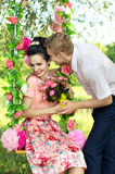 Happy young couple embracing in nature stock photography