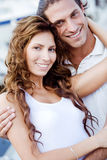 Happy young couple embracing outdoors Royalty Free Stock Image