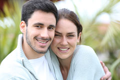 Happy young couple embracing outdoors Royalty Free Stock Images
