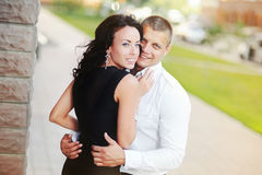Happy young couple embracing. At street Royalty Free Stock Photo