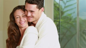 Happy young couple embracing together. In bathroom stock footage