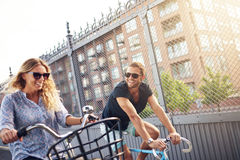Happy young couple enjoy a summer bicycle ride Stock Photos