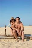 Happy young couple enjoying on beach Stock Image