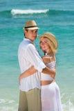 Happy young couple enjoying at beach stock photo