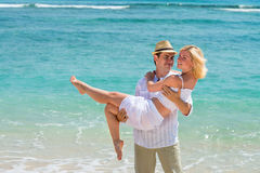 Happy young couple enjoying at beach Royalty Free Stock Photography