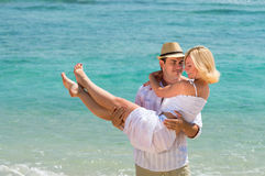 Happy young couple enjoying at beach Stock Images