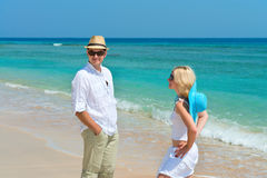 Happy young couple enjoying at beach stock image