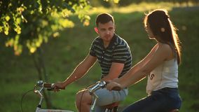 Happy young couple enjoying bicycle ride. Sunny summer time. Happy young couple enjoying bicycle ride stock video