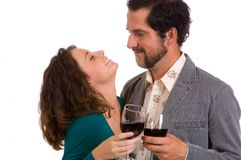 Happy Young Couple - enjoying a glass of wine Royalty Free Stock Photography