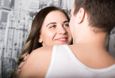 Happy young couple enjoying an intimate moment, laughing a lot and man gently strokes his partner's hair Stock Photography