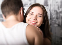 Happy young couple enjoying an intimate moment, laughing a lot and man gently strokes his partner's hair Royalty Free Stock Photo