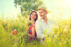 Happy young couple enjoying nature. Outdoors Royalty Free Stock Photography