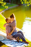 Happy young couple enjoying picnic. Toned image Royalty Free Stock Images