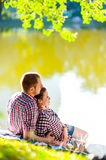 Happy young couple enjoying picnic. Toned image Royalty Free Stock Photo