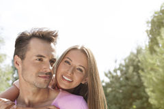 Happy young couple enjoying quality time in park Stock Photography