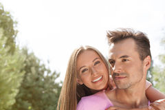 Happy young couple enjoying quality time in park Stock Image