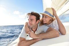 Happy young couple enjoying sailing Stock Photos
