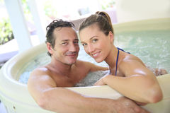 Happy young couple enjoying spa Stock Images