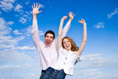 Happy young couple enjoying summer. Against the backdrop of blue sky Royalty Free Stock Image