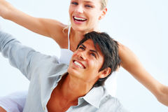 Happy young couple enjoying themselves Stock Images