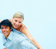 Happy young couple enjoying themselves Stock Photos