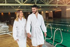Young couple enjoying treatments and relaxing at wellness spa center royalty free stock photography