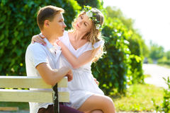 Happy young couple enjoying vacation at city park Stock Photo