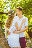 Happy young couple enjoying vacation at city park Stock Images
