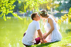 Happy young couple enjoying vacation at the lake Stock Photos