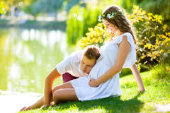 Happy young couple enjoying vacation at the lake Stock Images