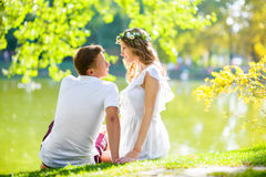 Happy young couple enjoying vacation at the lake Royalty Free Stock Images