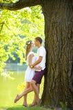 Happy young couple enjoying vacation at the lake Royalty Free Stock Photo