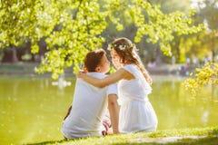 Happy young couple enjoying vacation at the lake Stock Image