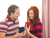 Happy young couple exchanging presents Stock Images
