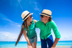 Happy young couple on exotic beach looking at camera Royalty Free Stock Image