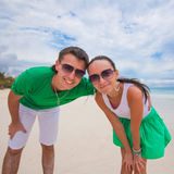 Happy young couple on exotic beach looking at Royalty Free Stock Photo