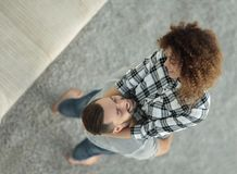 Happy young couple exulting in new apartment Stock Photography