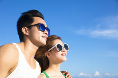 Happy young Couple face  with cloud background Stock Photography