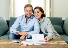 Happy young couple feeling proud of home finance. Young happy women feeling excited about saccessful accounting home finance in savings domestic and business stock photo
