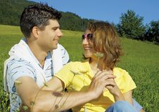 Happy young couple in field Stock Photography