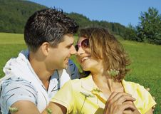 Happy young couple in field Stock Photos