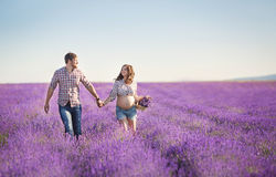 Happy young couple in a field of blooming lavender Royalty Free Stock Photo