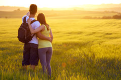 Happy Young couple on the field in spring Royalty Free Stock Image