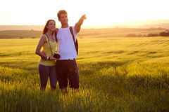 Happy Young couple on the field in spring Stock Photography