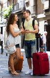 Happy young couple finding path with phone Royalty Free Stock Images